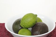 Whole Avocados and Limes Stock Photo