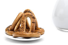 Whole bagels with poppy seeds on a plate Royalty Free Stock Photo