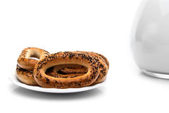 Whole bagels with poppy seeds on a plate. Sweet bread Stock Photography