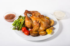 Whole baked chicken Royalty Free Stock Images