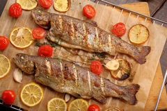 Whole baked fish on the grill Royalty Free Stock Photography