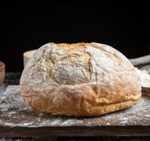 Whole baked round bread made from white wheat flour royalty free stock photography
