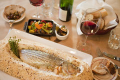 Whole baked sea bass with red wine Stock Images