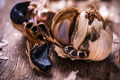 Whole balsamic black garlic Stock Photos