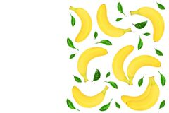 Whole bananas with leaves isolated on white background with copy space for your text. Top view. Whole bananas decorated with green leaves isolated on white Royalty Free Stock Images