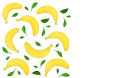 Whole bananas with leaves isolated on white background with copy space for your text. Top view. Whole bananas decorated with green leaves isolated on white Royalty Free Stock Photo