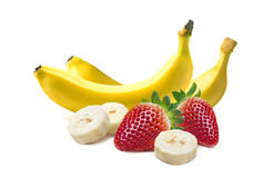 Whole bananas and strawberry composition on white backg stock images