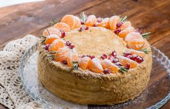Whole beautiful cake with decor. Of fruits and greens stock images