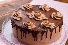 Whole beautiful cake with decor. Whole beautiful chocolate cake with cream roses royalty free stock images