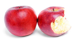 Whole  and bitten red  apples Royalty Free Stock Photos