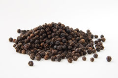 Whole black pepper macro Stock Image
