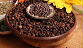 Whole black pepper and mustard Stock Photography