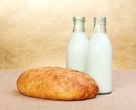 Whole bread and two milk bottles Royalty Free Stock Images