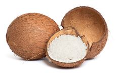 Whole and broken coconut on a white. Royalty Free Stock Image