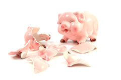 Whole and broken piggy bank Stock Photos