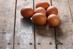 Whole Brown Eggs on Table Royalty Free Stock Images
