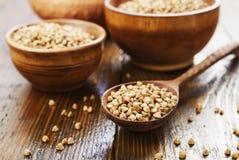 Whole buckwheat grain stock image