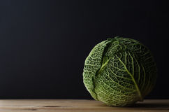 Whole Cabbage on Wooden Table Royalty Free Stock Photos