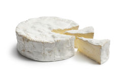 Whole Camembert cheese and pieces Royalty Free Stock Images