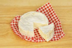 Camembert on a wooden board. Whole camembert cheese on a wooden chopping board stock photos