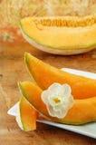 Whole Cantaloupe on a Wood Table Stock Photo