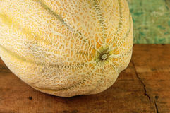 Whole Cantaloupe on a Wood Table Royalty Free Stock Image