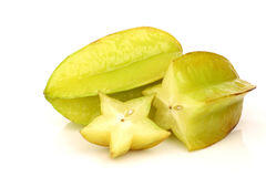 Whole carambola fruit and a cut one Stock Photos