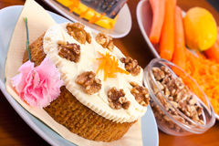 Whole carrot cake, walnuts and carrots Stock Image