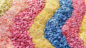 Whole cereal or grains are transformed into different colors royalty free stock photo
