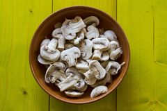 Whole Champignons in a Bowl on Wooden Boards Stock Image