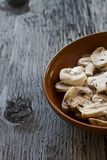 Whole Champignons in a Bowl on Wooden Boards Stock Photo