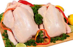 Whole chicken. Two whole chicken on vegetables Royalty Free Stock Image