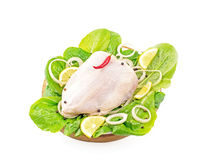 Whole chicken carcass on a wooden tray. With lemon Studio isolation Stock Photos