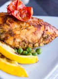 Whole chicken fillet baked in a spicy sauce with vegetables Stock Photography