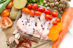 A whole chicken and soup vegetables Stock Images