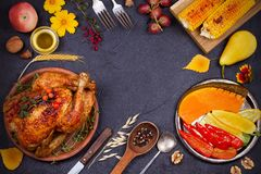 Whole chicken or turkey, fruits and grilled autumn vegetables: corn, pumpkin, paprika. Thanksgiving Day food concept Royalty Free Stock Images