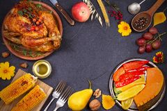 Whole chicken or turkey, fruits and grilled autumn vegetables: corn, pumpkin, paprika. Thanksgiving Day food concept Royalty Free Stock Photos