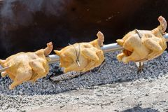 Whole chickens on the spit over flame. Royalty Free Stock Photos