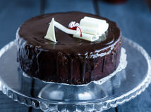 Whole chocolate cake with butter cream and cherries, birthday Stock Image