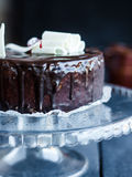 Whole chocolate cake with butter cream and cherries, sweet Stock Photo