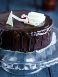 Whole chocolate cake with butter cream and cherries, sweet Stock Image