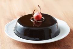 Whole chocolate cake on a dish royalty free stock photography