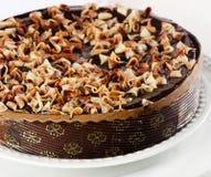 Whole Chocolate cake on  white plate Royalty Free Stock Image