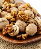 Whole and chopped walnuts Royalty Free Stock Image