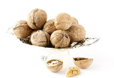 Whole and chopped walnuts Royalty Free Stock Images