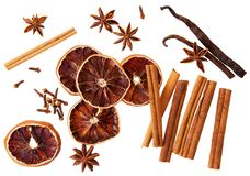 Whole cinnamon isolated. Whole cinnamon sticks, orange circle dry cloves, vanilla pods and spicy cloves isolated on white. Background,top view royalty free stock image