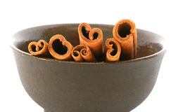 Whole cinnamon sticks. In brown bowl Stock Photography