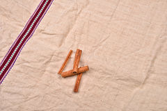 Whole cinnamon sticks on background of jute fabric Stock Photo