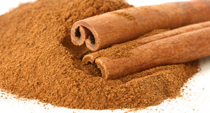 Whole cinnamon sticks and ground Stock Photos