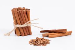 Whole cinnamon sticks with ground cinnamon Royalty Free Stock Photo